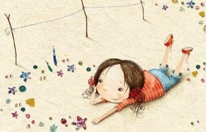Flicka i sand