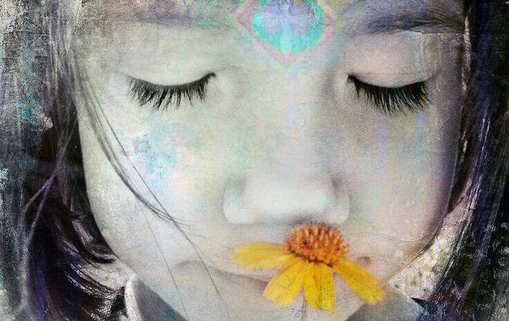 Flicka och blomma