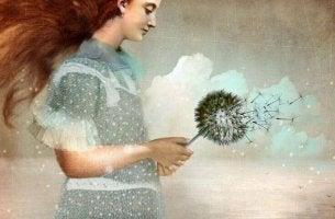Flicka med blomma