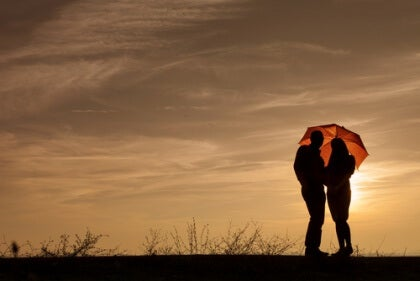 Paraply i solnedgång