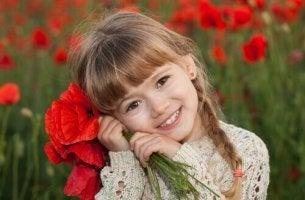 Flicka med blommor