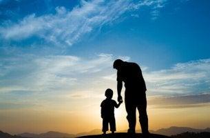 Far och son på kulle