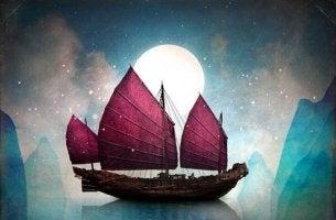 Båt framför månen
