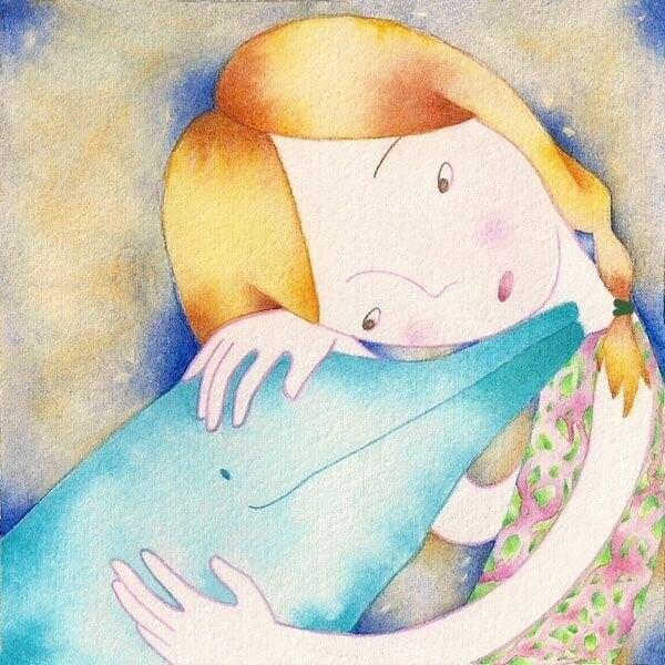 Flicka och delfin