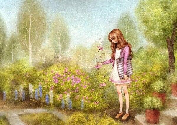 Flicka plockar blommor