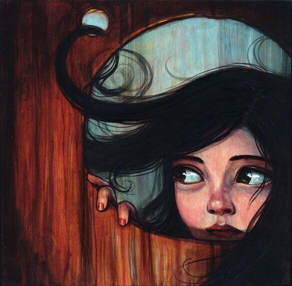 Flicka tittar genom hål
