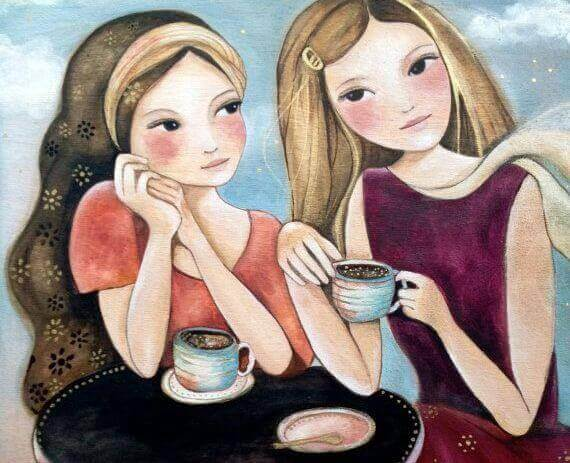 Flickor dricker kaffe