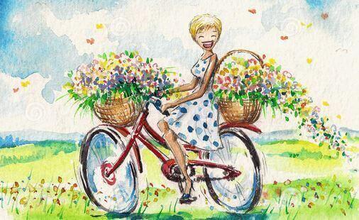Kvinna cyklar med blommor