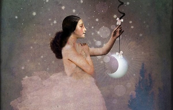 Kvinna håller måne