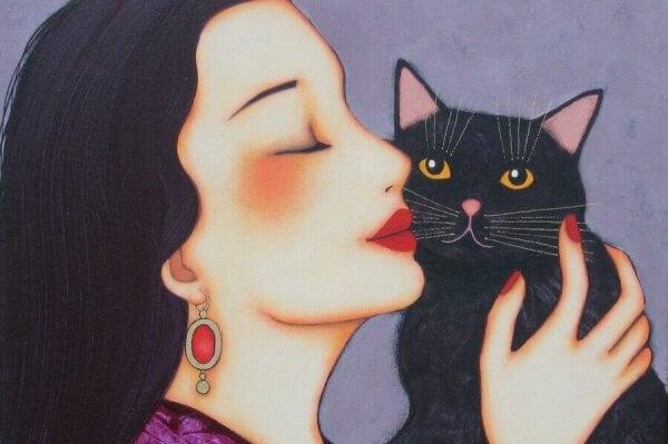 Kvinna kelar med katt