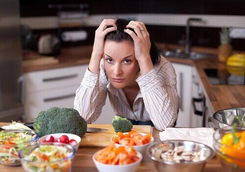 Kvinna vid grönsaker