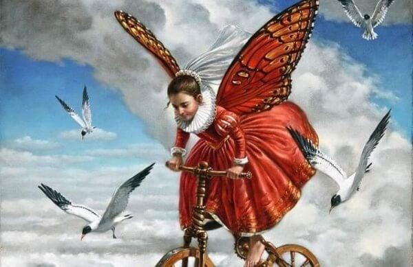 Bevingad flicka på cykel