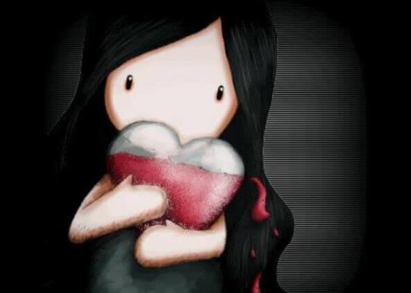 Flicka kramar hjärta
