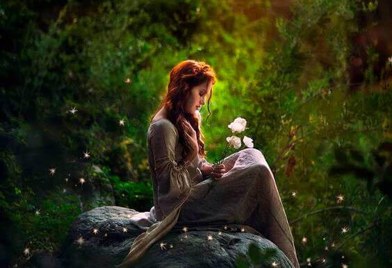 Kvinna med vita blommor