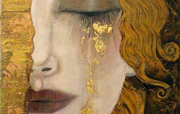 Kvinna gråter guld