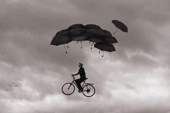 Man på flygande cykel