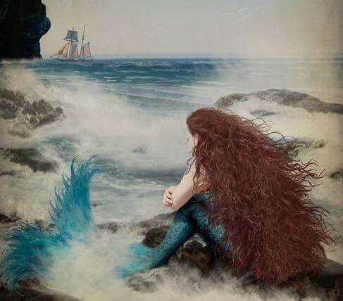 Sjöjungfru på klippa