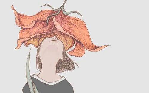 Flicka under blomma