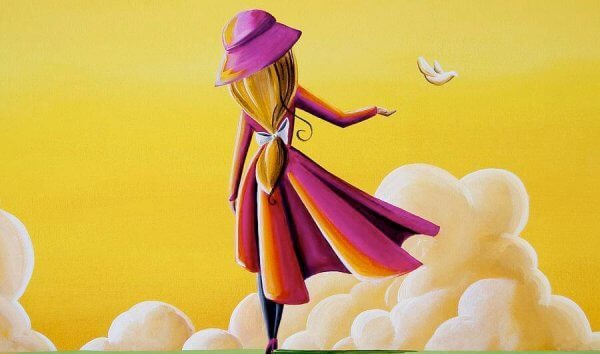 Kvinna framför gul himmel