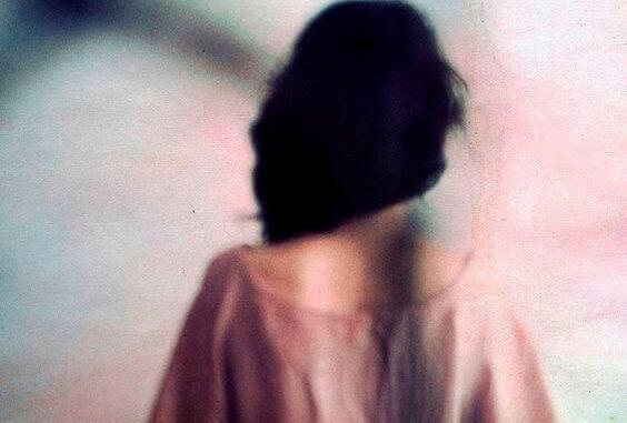 Kvinnas rygg
