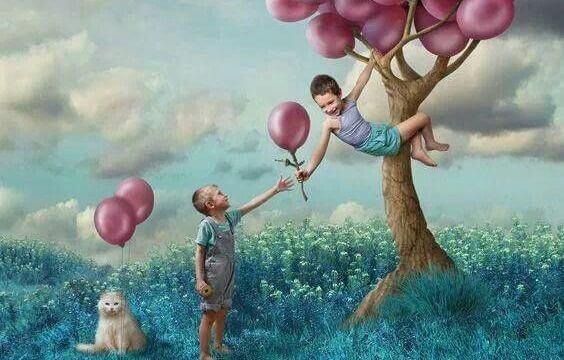 Barn med ballonger