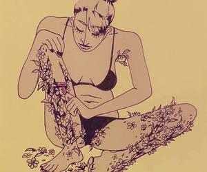 Kvinna rakar blommor
