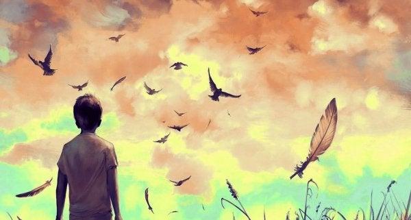 Pojke ser på fåglar