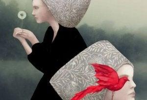 Flicka med röd fågel
