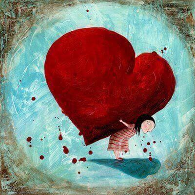 Kvinna bär hjärta
