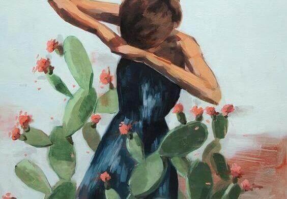 Kvinna bland kaktusar