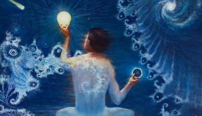 Man med boll av ljus