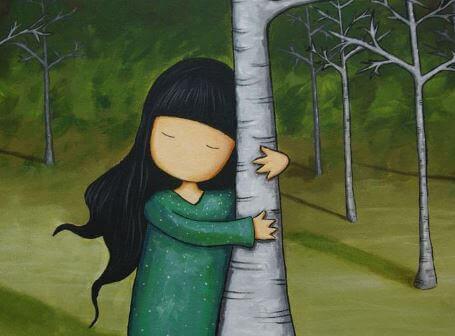 Flicka kramar träd