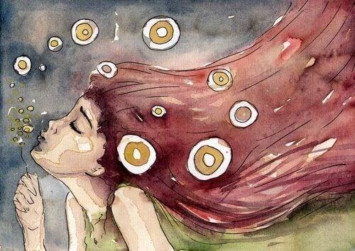 Flicka som blåser bubblor