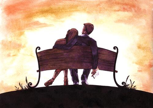 Lyckligt par på bänk