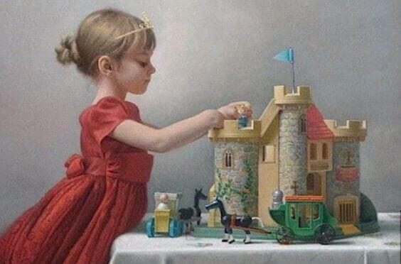 Flicka leker med slott