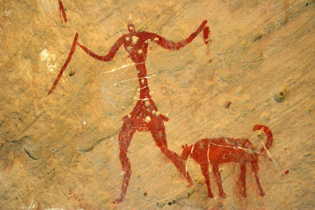 Grottmålning med man och hund