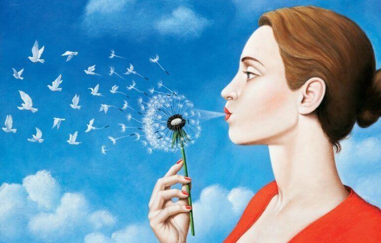 Kvinna som blåser duvor