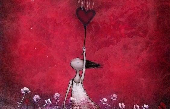 Kvinna som håller hjärta