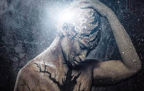 Man med huvudvärk