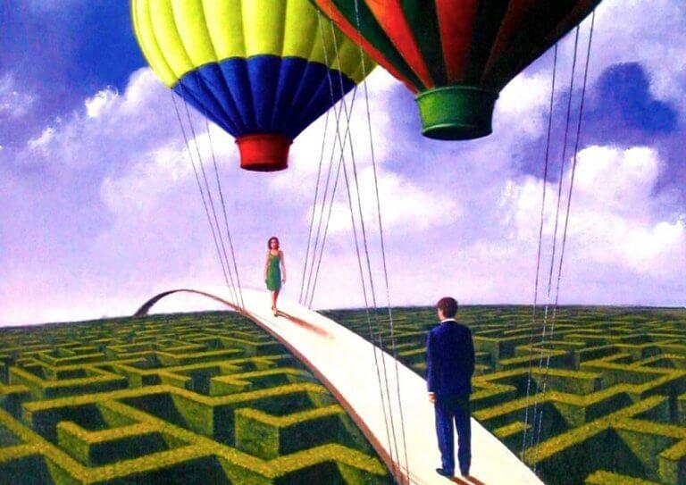 Man och kvinna på bro med ballonger