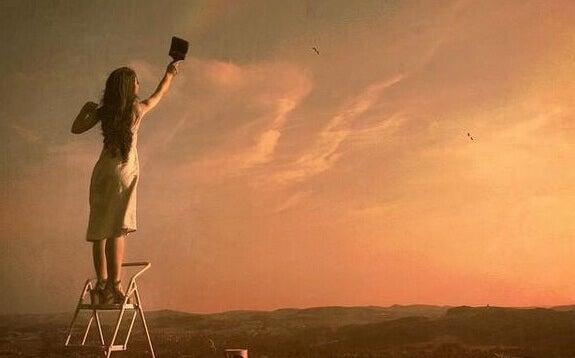 Kvinna målar himmel