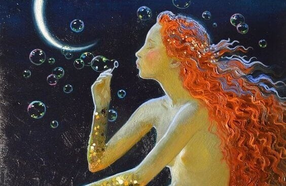 Kvinna som blåser bubblor