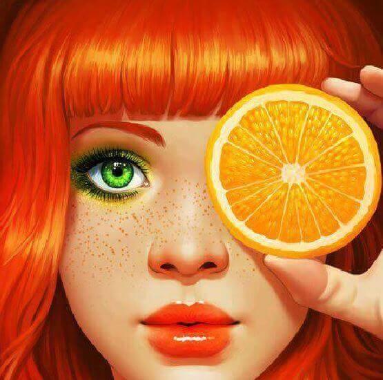 Kvinna med apelsin
