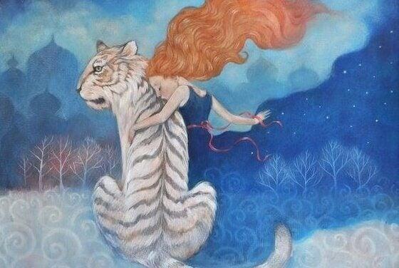 Kvinna och vit tiger