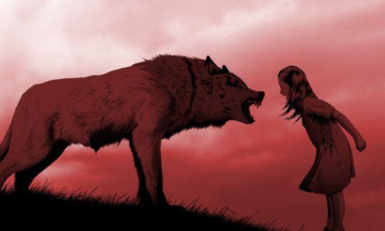 Bild som illustrerar boken Kvinnor som slår följe med vargarna, med en flicka och en varg som visar tänderna för varandra