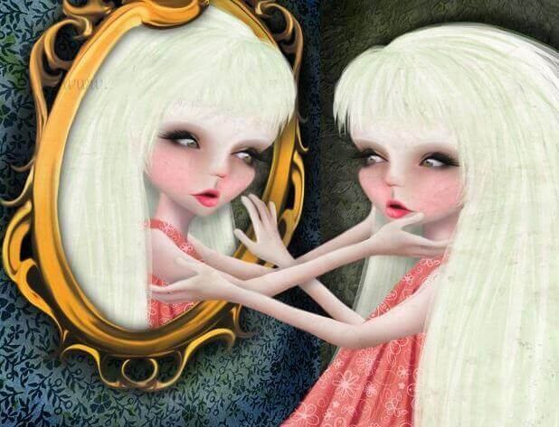 Kvinna som tittar i spegeln