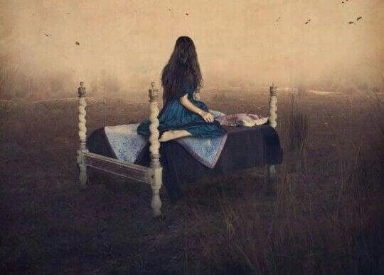 Kvinna på säng