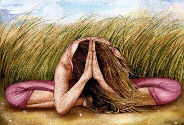 Kvinna som mediterar