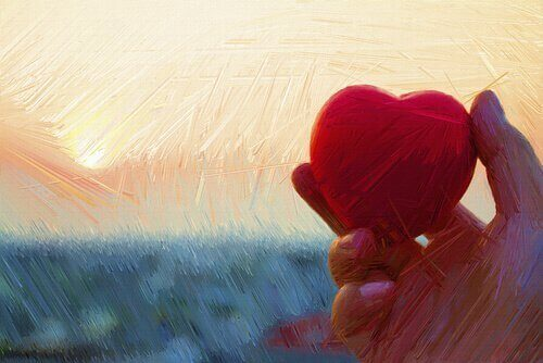Målning av person som håller i ett hjärta.