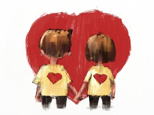 Par som håller hand framför hjärta.